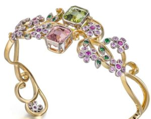 stella-bangle-18ct-fairtrade-gold-with-tourmalines-pink-sapphires-and-green-garnets-768x607